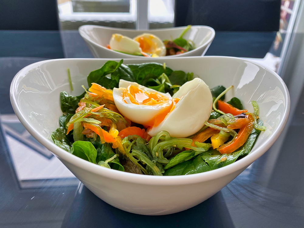 Seaweed salad with salmon spinach and boiled egg